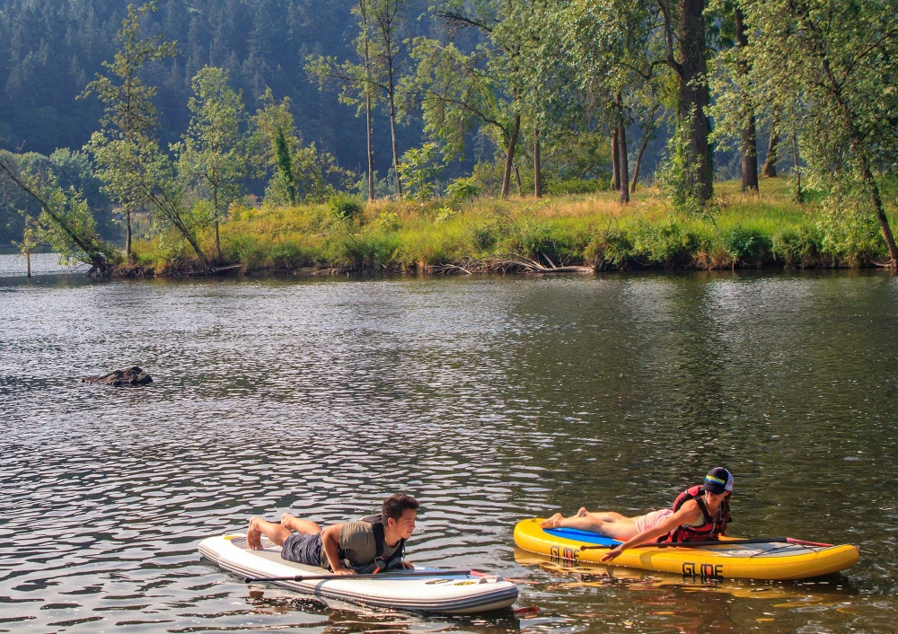 stand-up paddleboard yoga by eNRG Kayaking at Willamette Park in Oregons Mount Hood Territory.