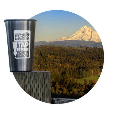 Mt. Hood Territory Tap Trail stainless steel pint glass superimposed over photo view of Mt. Hood from Sandy's Jonsrud Viewpoint