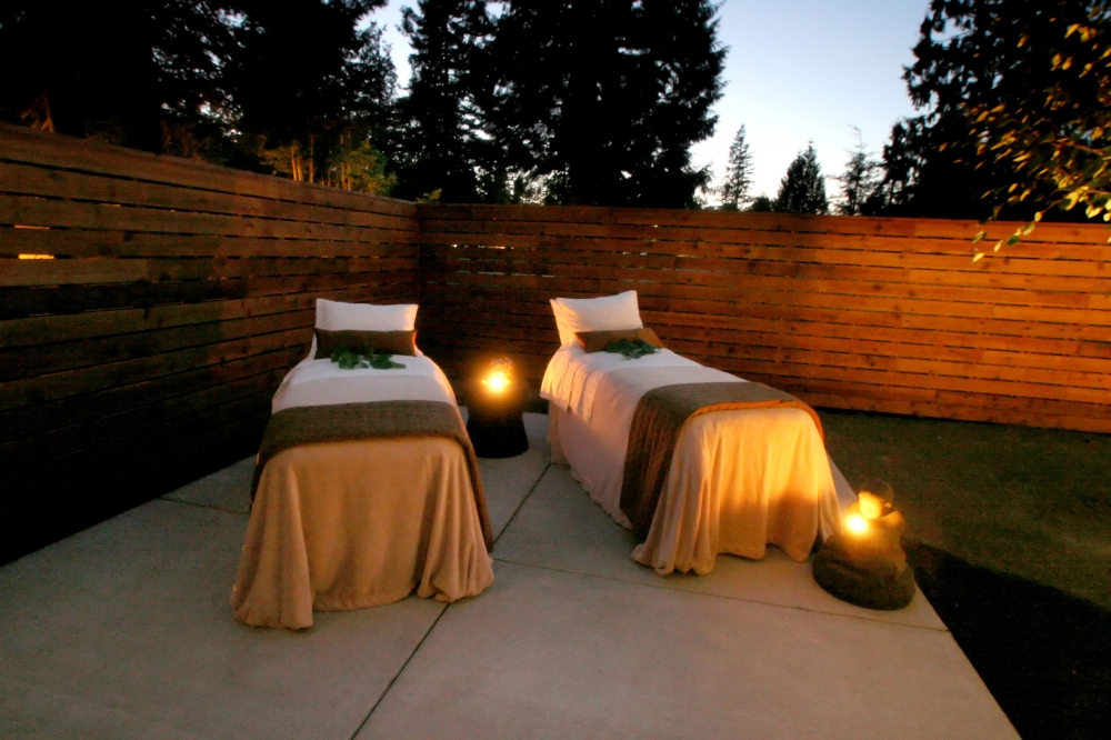 Two massage tables and candles for a couples massage at the Spa at Mount Hood Oregon Resort in Oregons Mount Hood Territory