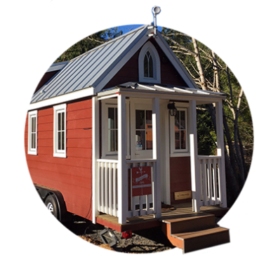 Scarlett, the tiny red, vacation rental house is the epitome of farmhouse charm at Mt. Hood Tiny House Village in Welches