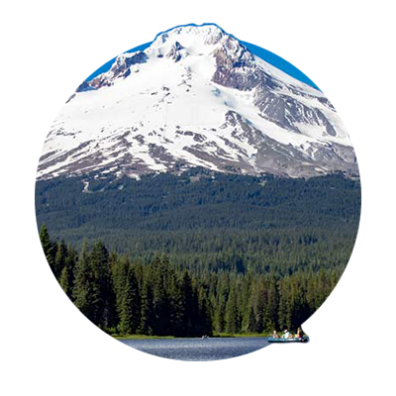 Circular photo, 90% which is Mt. Hood and the Mt. Hood National Forest looming over a sliver of Trillium Lake's blue waters.