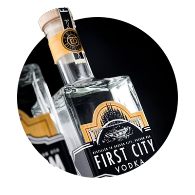 Circular photo of close-up of bottle of First City Vodka from trial Distilling in Oregon City