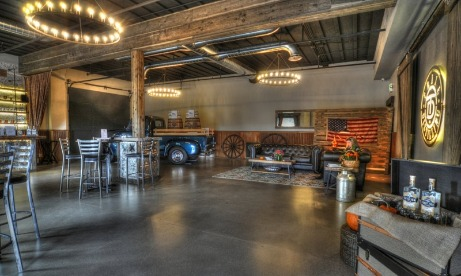 Interior view of Trial Distillings tasting room in Oregon City complete with metallic blue pickup with wood sideboards