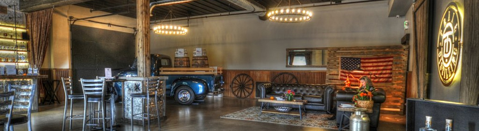 Interior view of Trial Distilling's tasting room in Oregon City complete with metallic blue pickup with wood sideboards