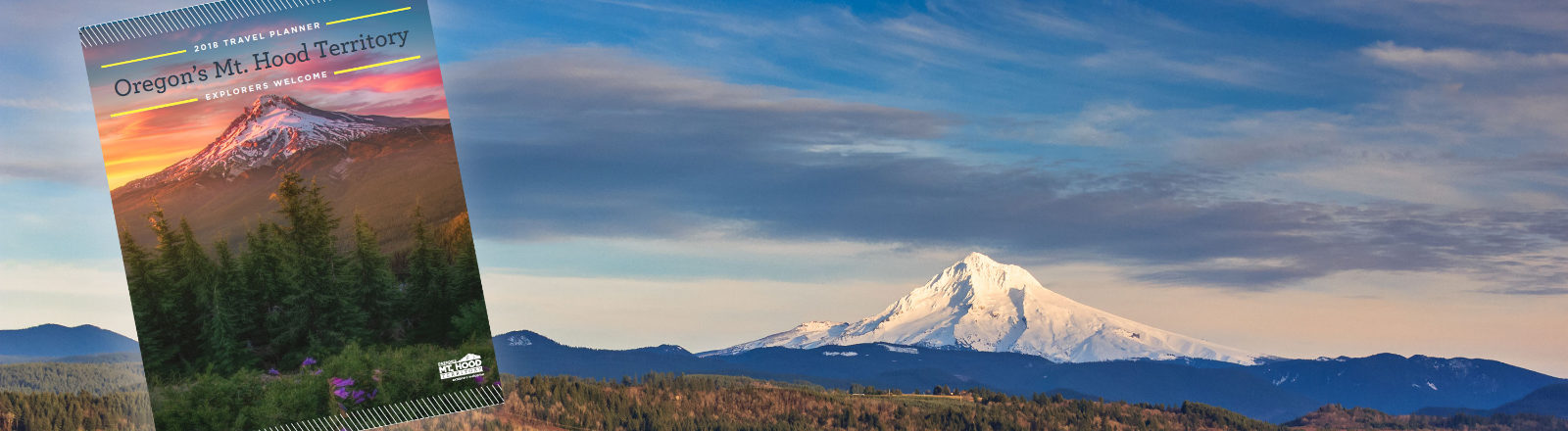 Snow white Mt. Hood with forest and autumn golf colored trees in forefront with travel planner superimposed on photo