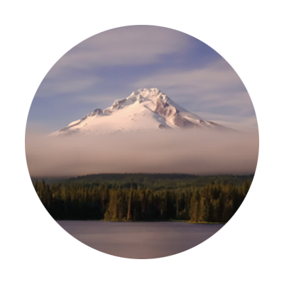 Circular photo of snow-covered Mt. Hood with low cloud bank over foothills as seen from Trillium Lake