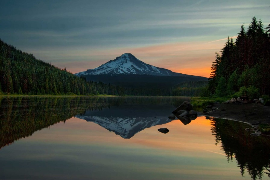 Sunrise over Mt Hood with the mountain's reflection casting itself across the deserted still waters of Trillium late