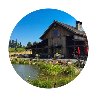 Tumwater Vineyard's trout poind and 2-story rustic and open Barrel House Tasting Room which was modeled after an old barn.