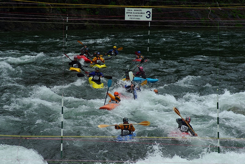 Kayakers work their way through the gates in the competition at the Upper Clackamas Whitewater Festival near Estacada in Oregons Mt. Hood Territory.