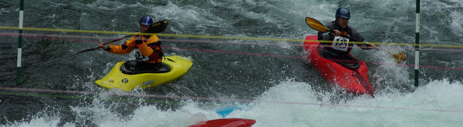 5 Kayakers in yellow and red hardshell kayaks paddling through gate at Upper Clackamas Whitewater Festival in Mt. Hood Territory