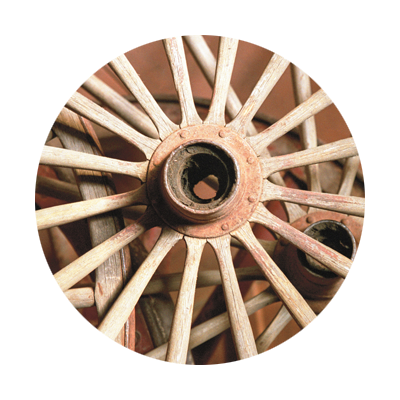 Close-up of wooden wagon wheels at Oregon City's End of the Oregon Trail Interpretive Center in Oregon's Mount Hood Territory