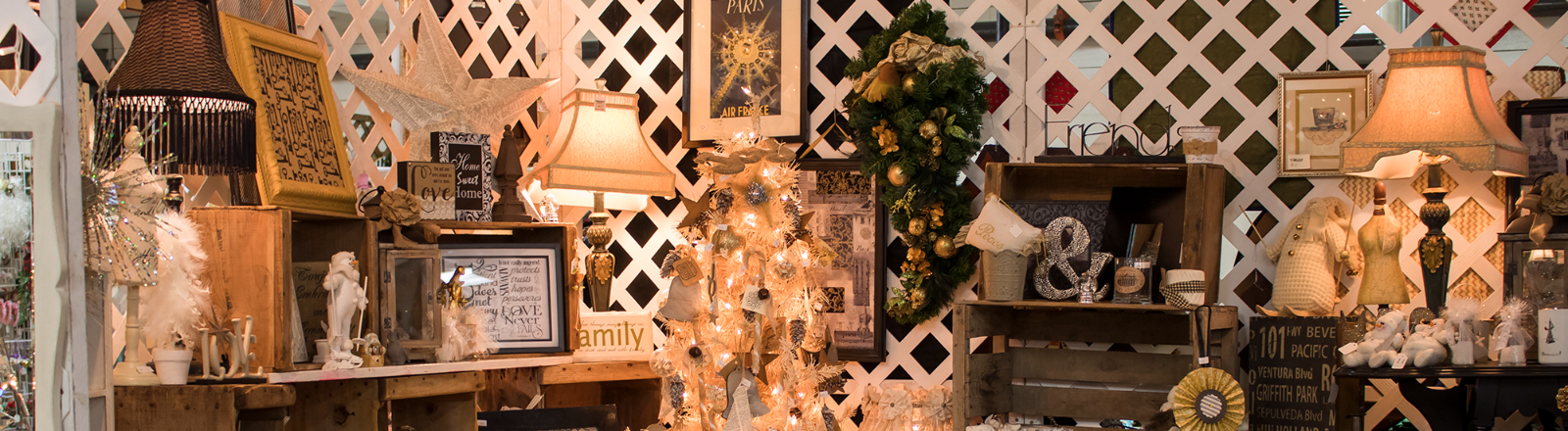 Display booth of mostly white and silver home decord and holiday items at the Country Christmas Bazaar in Canby