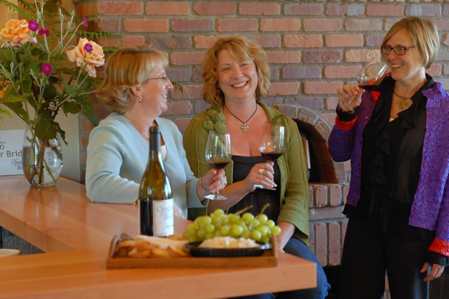 Three ladies wine tasting with fruit and cheese tray at Christopher Bridge Cellars in  Mt Hood Territory