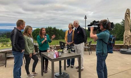KATU-TV cameraman videotapes female reporters interview of the owners of Petes Mountain and Campbell Lane Wineries