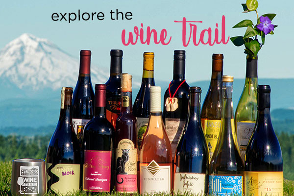 Explore the Wine Trail, collection of bottles from participating wineries and a stainless Mt. Hood Territory wine glass with Mt. Hood in background.