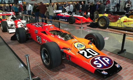 Orange and red #20 STP sponsored Indy race car on display with other Indy cars at Wilsonvilles World of Speed Museum exhibit