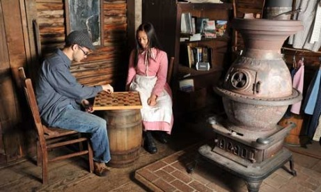 Kids play checkers at Philip Foster Farm in Mount Hood Territory